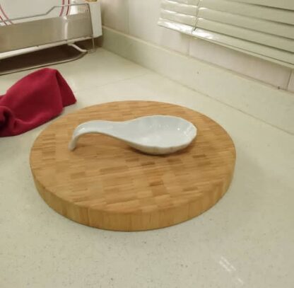 Ceramic spoon rest with eclectic style.